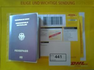 Mein Reisepass mit dem Rücksendebrief